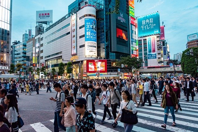 People crossing street in city in Japan